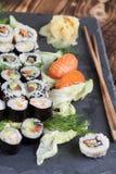 Sushi set on a slate stone. Sushi set on a slate board. Maki, uramaki and nigiri sushi stock photo