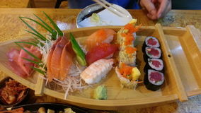Sushi set on small boat. And savory Royalty Free Stock Photos