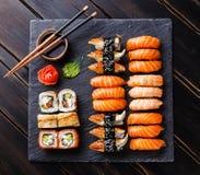 Sushi Set on stone slate Stock Photos