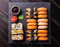Sushi Set on stone slate. Sushi Set on black stone slate background royalty free stock image