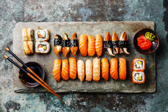 Sushi Set on stone slate. Sushi Set served on gray stone slate on metal background Stock Photos