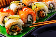 Sushi set: sushi roll with salmon and sushi roll with smoked eel Stock Photos