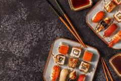 Sushi Set: sushi and sushi rolls on plate. Sushi Set: sushi and sushi rolls on plate, top view Stock Photos