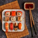 Sushi Set: sushi and sushi rolls on plate. Sushi Set: sushi and sushi rolls on plate, top view Stock Image
