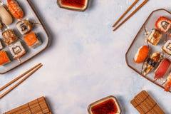 Sushi Set: sushi and sushi rolls on plate. Sushi Set: sushi and sushi rolls on plate, top view Stock Images