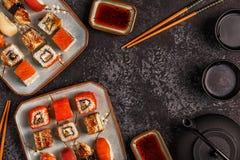 Sushi Set: sushi and sushi rolls on plate. Sushi Set: sushi and sushi rolls on plate, top view Stock Photography