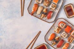 Sushi Set: sushi and sushi rolls on plate. Sushi Set: sushi and sushi rolls on plate, top view Royalty Free Stock Photo