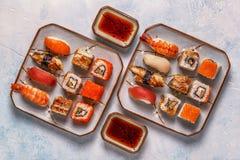 Sushi Set: sushi and sushi rolls on plate. Sushi Set: sushi and sushi rolls on plate, top view Stock Photo