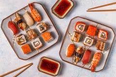 Sushi Set: sushi and sushi rolls on plate. Sushi Set: sushi and sushi rolls on plate, top view Royalty Free Stock Photography