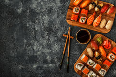 Sushi Set: sushi and sushi rolls on wooden plate. Royalty Free Stock Photography