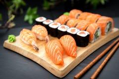 Sushi set Traditional Japanese Food. Nigiri sushi with fresh salmon and prawn. Sushi maki with salmon and philadelphia roll Royalty Free Stock Image