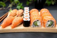 Sushi set Traditional Japanese Food. Nigiri sushi with fresh salmon and prawn. Sushi maki with salmon and philadelphia roll Stock Photos