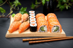 Sushi set Traditional Japanese Food. Nigiri sushi with fresh salmon and prawn. Sushi maki with salmon and philadelphia roll Stock Images