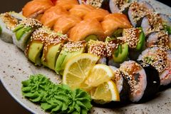 Sushi set with wasabi and lemon on a plate. Sushi with wasabi and lemon on a plate royalty free stock image