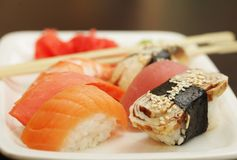 Sushi set on white plate Stock Images