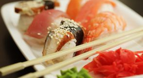 Sushi set on white plate Royalty Free Stock Photos