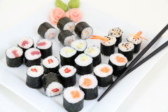 Sushi set on white plate. Traditional japanese sushi rolls Stock Images