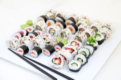 Sushi set on white plate. Traditional japanese sushi rolls Royalty Free Stock Photography