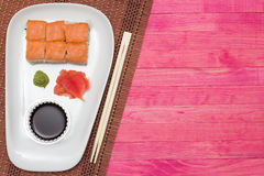 Sushi  set on white plate with wasabi and  ginger Royalty Free Stock Photo