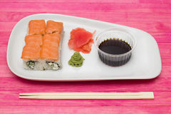 Sushi  set on white plate with wasabi and  ginger Royalty Free Stock Photography