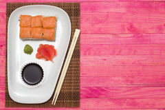 Sushi  set on white plate with wasabi and  ginger Royalty Free Stock Images