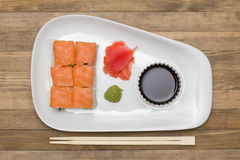 Sushi  set on white plate with wasabi and  ginger Stock Photography