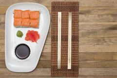 Sushi  set on white plate with wasabi and  ginger Royalty Free Stock Photos
