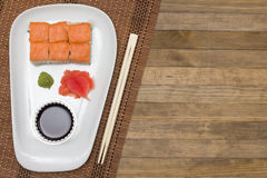 Sushi  set on white plate with wasabi and  ginger Royalty Free Stock Image