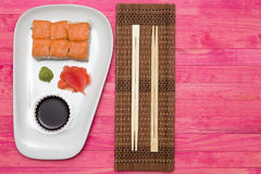 Sushi  set on white plate with wasabi and  ginger Stock Photo