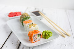 Sushi set on white wooden background. With wasabi, ginger and soy sauce Royalty Free Stock Photos