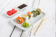 Sushi set on white wooden background. With wasabi, ginger and soy sauce Stock Photos