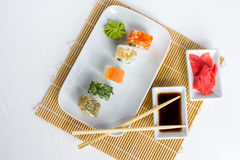 Sushi set on white wooden background. With wasabi, ginger and soy sauce Royalty Free Stock Images