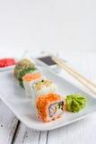 Sushi set on white wooden background Stock Photo