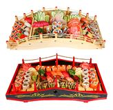 Sushi set on wooden bridges on a white background royalty free stock photography