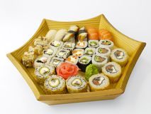 Sushi set on a wooden plate Royalty Free Stock Image