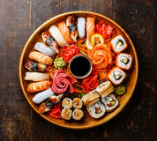 Sushi Set in wooden round tray Royalty Free Stock Photos