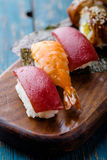 Sushi set on a wooden tray. Stock Photos