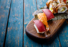 Sushi set on a wooden tray. Stock Image