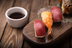 Sushi set on a wooden tray Stock Photos