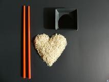 Sushi setup rice chopstick soy sauce bowl Royalty Free Stock Images