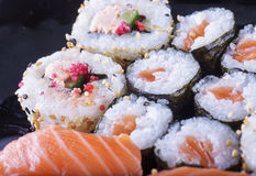 Sushi of several types over black plate Stock Photography