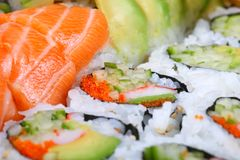 Sushi, shallow focus. Sushi rolls with salmon and avacado, shallow focus stock photography