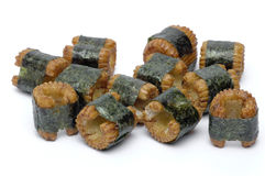 Sushi-shaped, small pastry pieces. Wrapped with seaweed, seaweed, and a strong fishy taste Royalty Free Stock Photo