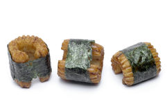 Sushi-shaped, small pastry pieces. Wrapped with seaweed, seaweed, and a strong fishy taste Royalty Free Stock Image