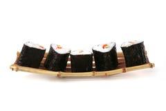 Sushi on small bamboo boat Stock Photos