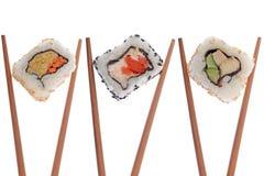 Sushi som isoleras på vit Arkivfoto
