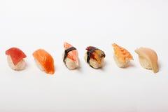 Sushi som isoleras på vit Arkivbild