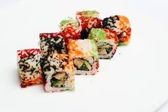 Sushi som isoleras på vit Fotografering för Bildbyråer