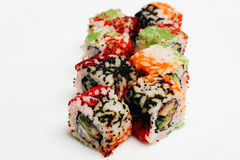 Sushi som isoleras på vit Royaltyfria Foton