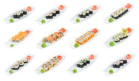 Sushi (sorterad rulle) på en vit bakgrund Arkivbilder